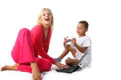Mom and son. Young lovely mom and son with pc and digital photo camera Stock Image