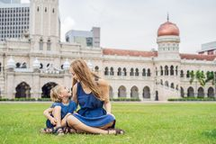 Mom and son on background of Merdeka square and Sultan Abdul Samad Building. Traveling with children concept.  stock image