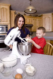 Mom and son baking. A mother and son preparing and mixing cookie dough Stock Photo