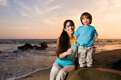 Mom and son on beach 2 Stock Photo