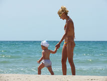 Mom and son at the beach Stock Photography