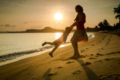 Mom and son on the beach. At sunset royalty free stock images