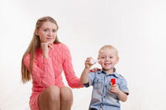 Mom and son blow bubbles Stock Photography