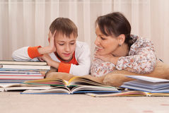 Mom with son and books Royalty Free Stock Photos