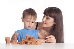 Mom and son constructing Royalty Free Stock Photo