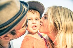 Mom and son. Mom and dad kissing their handsome son - Family and baby outdoors Royalty Free Stock Photos
