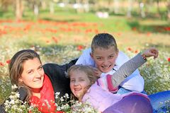 Mom with son and daughter in the park fooled Royalty Free Stock Photo