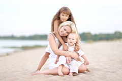 Mom with son and daughter. In summer nature Royalty Free Stock Image