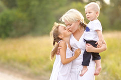 Mom with son and daughter. In summer nature stock image