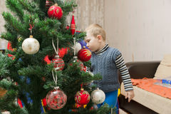 Mom and son decorate the Christmas tree Stock Photos