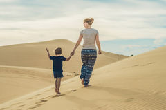 Mom and son in the desert. Traveling with children concept Stock Photos