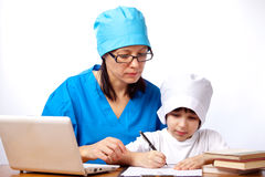 Mom and son doctors Stock Image
