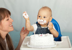 Mom and son eating cake. Mom and son eating birthday cake Royalty Free Stock Photography