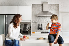 Mom and Son Eating Togetherness Cheerful Concept Royalty Free Stock Photos