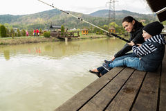 Mom and son fishing Stock Photography
