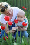 Mom with son and flowers for the Mothers day Stock Images