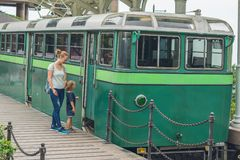Mom and son are going to go on an old tram. Traveling with child Royalty Free Stock Photos
