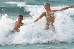 Mom and son have Fun in the oceans Waves Royalty Free Stock Photo
