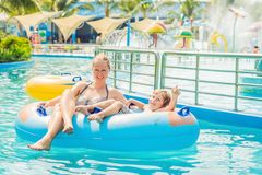 Mom and son have fun at the water park Royalty Free Stock Photo