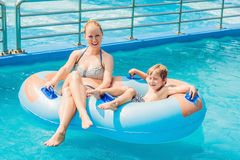 Mom and son have fun at the water park.  stock images