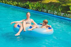 Mom and son have fun at the water park.  royalty free stock images