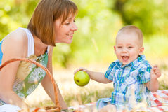 Mom and son have a picnic. This image has attached release Royalty Free Stock Photo