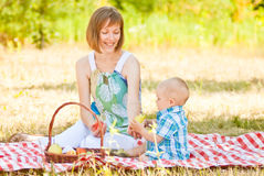 Mom and son have a picnic Stock Images