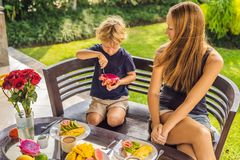 Mom and son are having breakfast on the terrace royalty free stock photos