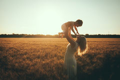 Mom and son having fun by the lake, field outdoors enjoying nature. Stock Photography