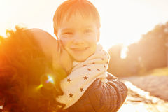 Mom and son having fun by the lake. Warm filter and film effect Stock Photography