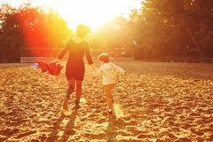 Mom and son having fun by the lake Royalty Free Stock Photography