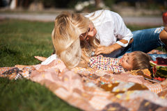 Mom and son having fun outdoors. Mother with kids have fun on the grass stock photos