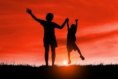 Mom and son having fun at sunset,  family a happy time, Asian kid,Silhouette a kid at the sunset. Royalty Free Stock Photos