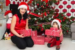 Mom and son holding presents Stock Images