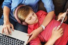 Mom Son Holidays Using Electronics Multimedia Concept Royalty Free Stock Photos