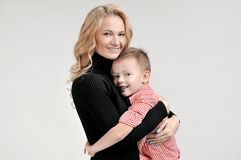 Mom and son are hugging on isolated background. Mother, father and son on isolated background Royalty Free Stock Images