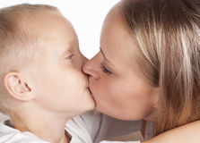 Mom and son kissing Stock Image