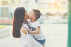 Mom and son kissing. Stock Photo