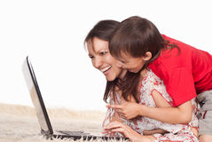 Mom and son with laptop. Portrait of a mom and son with laptop Royalty Free Stock Image