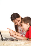 Mom and son with laptop. Cute mom with son and laptop on carpet Stock Photography
