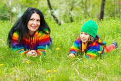 Mom and son laying in grass Stock Photos