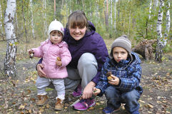 Mom with son and little daughter in the forest Stock Photography