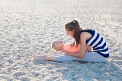 Mom and son little play on the beach Royalty Free Stock Photography