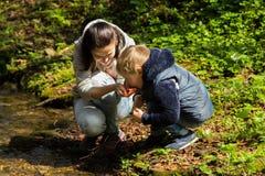 Mom and son near the river Stock Photos