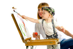 Mom and son paint colors. Studio white background royalty free stock image