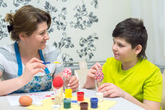 Mom and son paint Easter eggs Royalty Free Stock Images