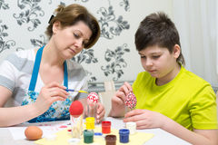 Mom and son paint Easter eggs Stock Photo