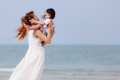 Mom and son play on beach Royalty Free Stock Photo