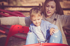 Mom and son play in park Royalty Free Stock Photo