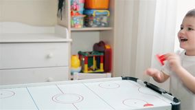 Mom and son play with passion in air hockey HD 1920x1080 stock video